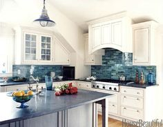 One of my favorite kitchens! White with blue, absolutely perfect.