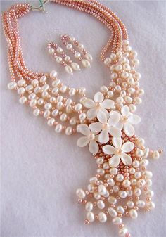 Pearl necklace.  Follow us @SIGNATUREBRIDE on Twitter and on FACEBOOK @ SIGNATURE BRIDE MAGAZINE
