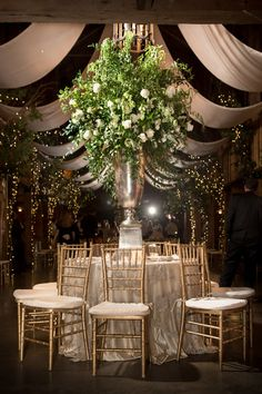 A show-stopping wedding centerpiece - huge green and white floral centerpiece in tall silver vessel  {Photo Love Photography}