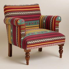 Make a global style statement with our Mirza Chair, crafted in India of mango wood. Featuring a traditional stripe design in bright colors, its heavyweight tapestry-woven cotton upholstery reminds us of an intricate kilim.
