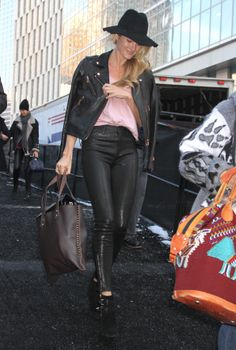 Candice Swanepoel pairs her pink t-shirt with a leather jacket // #Fashion #StreetStyle