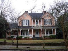 One of the premier historic houses in Americus. Main rooms on ground floor have original trim, fireplaces, floor-length windows, beautifully molded plaster ceilings, and heart-pine floors. Heart Pine Flooring, Pine Floors, Folk Victorian, Victorian Homes, Old Houses For Sale, Historic Properties, Old House Dreams, Historic Homes, Ground Floor