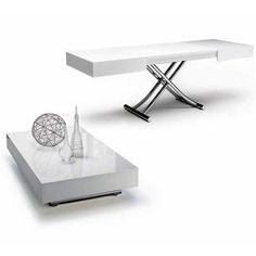 The Cristallo is a transforming coffee table with glass top and metal frame. Adjustable to various heights, including dining, with two self-storing leaves.