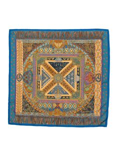 Slate blue and multicolor Hermès silk scarf with 'Sur un Tapis Volant...' motif and hand rolled edges.