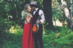 glam musical engagement shoot in the woods, love the red dress | CHECK OUT MORE IDEAS AT WEDDINGPINS.NET | #weddings #engagement #engaged #thequestion #events #forweddings