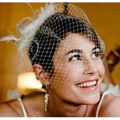 Feather veil and comb. Click the image to purchase. Click image to purchase.