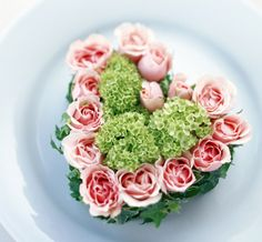 Cute heart shaped arrangement for Valentine's Day with pink roses and baby green hydrangea!  You can find both on http://www.flowermuse.com