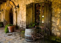 Antique Tuscany Style doors and stone walls.
