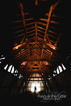 Tim Burton styled Wedding Photography - quirky bride with a love for Tim Burton - a great long tall silhouette in the old barn at Arley Hall.