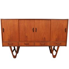 Midcentury Danish Teak Credenza or Buffet with Hairpin Legs | From a unique collection of antique and modern buffets at https://www.1stdibs.com/furniture/storage-case-pieces/buffets/