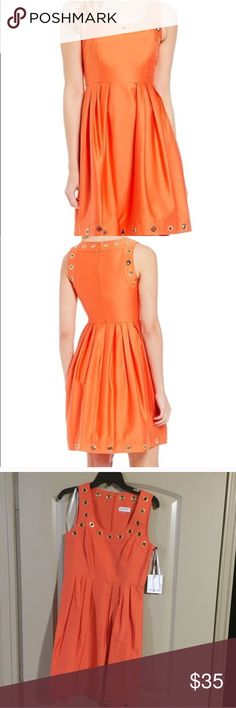 NWT Calvin Klein Orange Gold Grommet Dress Sz 4 Beautiful fit and flare orange dress with gold grommets along the neckline and bottom of dress. Scoop neckline. Absolutely stunning. Calvin Klein Dresses