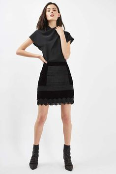 The ideal going-out skirt, this piece comes in a luxe velvet with lace panel detail at the front. In a mini, high waist fit, style casually with a plain tee and ankle boots or dress up the look with a ruffle blouse and heeled sandals. #Topshop