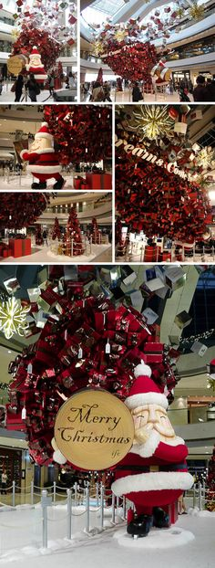 Present tree Santa held up during the month of December at the IFC  Hong Kong. Via Bluebalu
