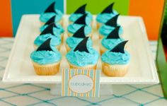 i wish i would have made these for the first round of the playoffs...shark bites! (mini cupcakes - ketchup cups)