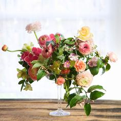 "Kiana Underwood / tulipina.com | Photography: Nathan Underwood / nruphoto.com  -  ""This arrangement included everything from my garden sans the ranunculus. Citrus blossoms, hellebore, viola, hydrangea, rose, and snow bush."