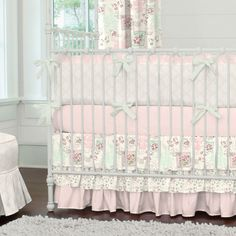 Blush Vintage Stamp Crib Bedding by Carousel Designs.