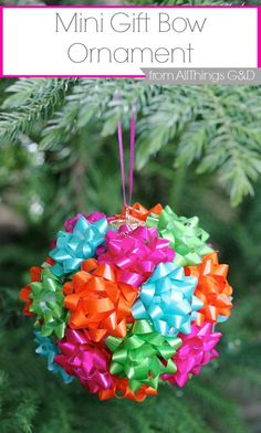 This DIY mini gift bow ornament is the easiest thing you'll make this holiday season.  Enjoy it on your tree or tape to a present for added (and reusable!) flair!  by All Things G&D #allthingsgd