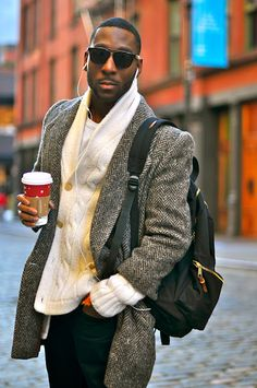 Herringbone overcoat with cable-knit sweater