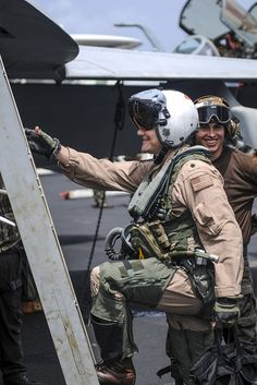 """GULF OF OMAN (Aug. 28, 2013) -- Cmdr. Robert Loughran, commanding officer of the """"Argonauts"""" of Strike Fighter Squadron (VFA) 147, climbs the ladder of an F/A-18E Super Hornet on board the aircraft carrier USS Nimitz (CVN 68). Loughran completed his 1,000th carrier arrested landing, or """"trap"""", on board Nimitz Aug. 28. Nimitz Strike Group is deployed to the U.S. 5th Fleet area of responsibility conducting maritime security operations, theater security cooperation efforts and support missions for…"""