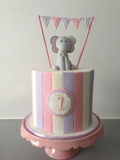 First birthday cake with gum paste elephant topper and bunting by Finesse Cakes by Ingrid, Melbourne