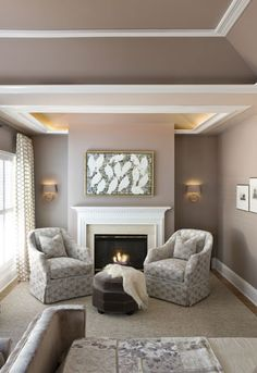 #Swivel #chairs from 2 Ivy Lane flank the #fireplace in this #master #bedroom. #interior #design #furnishings