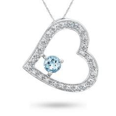 Sterling Silver, diamond and blue topaz gemstone pendant