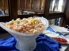 This is an ice sculpture filled with our large boiled shrimp that i hand pick right off of the docks in Galveston.  Chopin Mon Ami Catering & Cakes  Gavleston TX