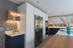 Integrated Miele appliances ensure the sleek, uncluttered finish is maintained in this handleless kitchen by Planet Furniture. Miele Kitchen, Handleless Kitchen, Kitchen Furniture, Planets, Kitchen Cabinets, Appliances, Table, House, Kitchens