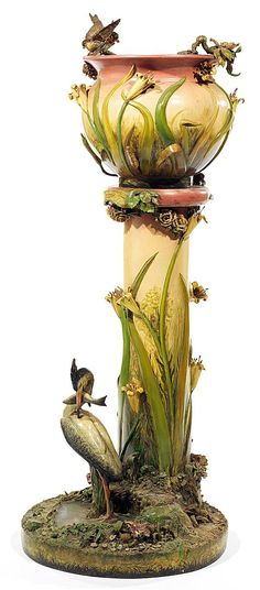 Art Nouveau tall faïence jardiniere on a column with polychrome decorations of herons, flowers, grasses, etc... France
