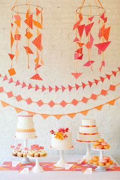 orange & pink party spread @Jess Liu Ellibee LOVE the different shaped banners!