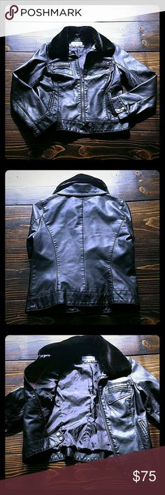 NWOT Calvin Klein faux leather jacket size s Sporty detachable fur collar. 4 pocket zip up. Nwot removed tags. Still has button tag attached. IMO will fit med as well.  Bust approx 19 waist 17.5 top to bottom 23 sleeve 24 shoulder 16.  NWOT Calvin Klein Jackets & Coats