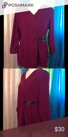 NWOT LAURA ASHELY TOP 300 2/17 Beautiful pullover wine top. V neck in front with black adjustable buckle on the side. Opens under the buckle to adjust around the hip . 95% polyester 5% spandex Laura Ashley Tops