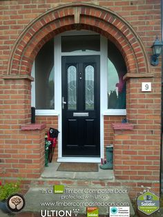 Contemporary Italia, Solidor Composite Doors by Timber Composite Doors are brought to you with our Italia Range of Timber Core Doors. Italia doors emanate modern Italian elegance that is fused with British craftsmanship. Arched Front Door, Black Front Doors, Glass Front Door, Porch Uk, Porch Roof, Black Composite Door, Exterior Wall Design, Porch Storage, Brick Arch