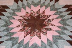 We love the colors of this Amish made Star in Common Quilt
