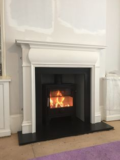 Wood burning stove installation with timber surround -Dean forge Dartmoor woo. Dartmoor, Stove Fireplace, Fireplace Ideas, Stove Installation, Log Fires, Log Burner, Fireplace Surrounds, Wood Burning, Home Furnishings
