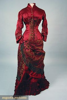 SATIN & BROCADE BUSTLE DRESS, 1870s 1-piece claret satin w/ brown brocade, beaded net & fringed trim & beaded buttons (few losses to buttons), lined in glazed cotton.