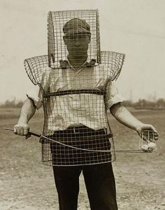 How they collected range balls back before tractors and golf carts....a man's man!