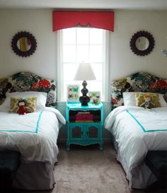 This lovely girls room is whimsical yet bold with its floral headboards and the brave combination of red and fluorescent turquoise.