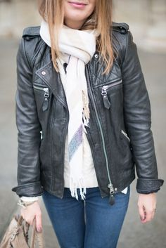 Leather jacket, skinny jeans, scarf, and booties with a cute handbag. Great way to incorporate the leather trend into your wardrobe and soften it up.