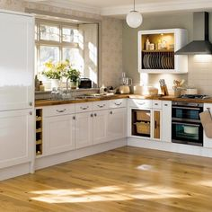 This kitchen reminds me of my mom's cooking. Loving the wooden worktop!