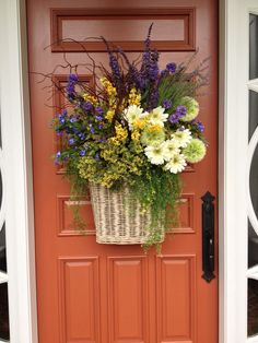 I love easy DIY summer wreaths, don't you? They bring a pop of color and a bit of character to your front door. Here we've gathered 60 Lovely Summer Wreath Design Ideas and Remodel hopes of getting you into the crafty spirit! Spring Door Wreaths, Summer Wreath, Basket Flower Arrangements, Floral Arrangements, Front Door Decor, Wreaths For Front Door, Front Doors, Front Porch, White Wreath