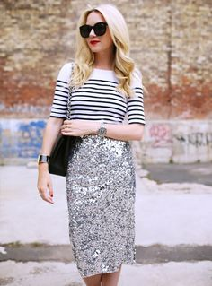 Blair Eadie in a striped shirt, silver sequin skirt, black bag, and sunglesses | @andwhatelse