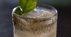 Summit Bar owner Greg Seider shows uswhy a simple mix of lime, agave…