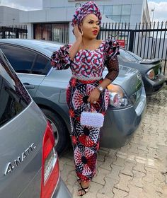 Image may contain: one or more people, people standing, car and outdoor African Inspired Fashion, Latest African Fashion Dresses, African Print Dresses, African Print Fashion, Ankara Fashion, African Prints, Ankara Long Gown Styles, Trendy Ankara Styles, Ankara Gowns