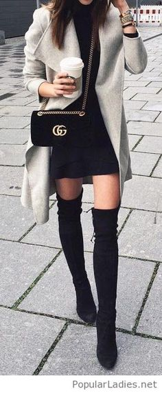 Black dress, boots and bag with a grey coat