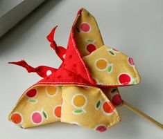 These are really cute! I need to make some :) The Patchsmith: Origami Fabric Butterflies from Across the Pond