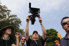 Director Ron Howard photographs the crowd at Made in America on September 1, 2012. ( MICHAEL S. WIRTZ / Staff Photographer )