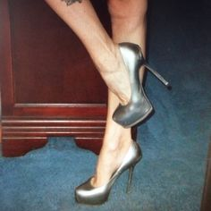 "YVES SAINT LAURENT SILVER STILETTO PUMPS 40 **WEAR PRE-LOVED CONDITION!!  Lots of scuffing to out soles and heel taps. Leather has scratches and some stretching. 6"" stiletto heel. 1 1/2"" platform. STILL LIFE IN THEM, see photos. AUTHENTIC. Yves Saint Laurent Shoes Heels"