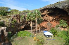 In a large sinkhole at the edge of Makauwahi Cave on the island of Kauai, a team of archaeologists and volunteers is searching for the remains of Hawaii's human and environmental history.