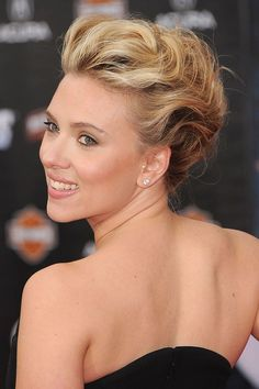 A plait through the side and back, pulling some of the front out to create a quiff like effect.